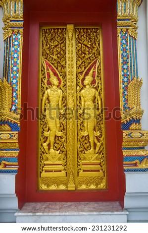 Angel decoration of buddhist temple door - stock photo
