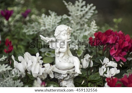 Angel figure and flowers