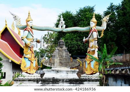 Angel holding bell at Wat Phra That Suthon Mongkhon Khiri in Phrae, Thailand - stock photo