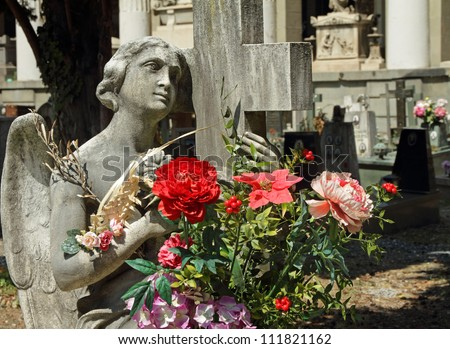 angel holding flowers on monumental cemetery, Staglieno, Italy, Europe - stock photo