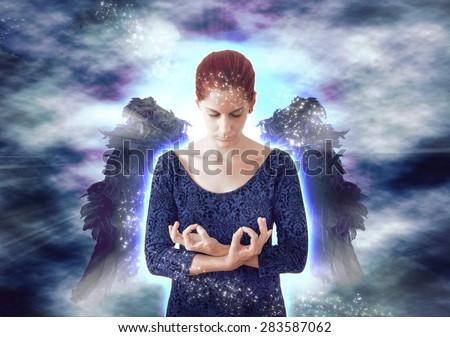 Angel meditating - stock photo