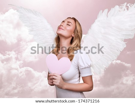 Angel of love, cute girl with closed eyes in pink sky, cupid costume, fairy tale, fantasy dreaming, Valentine day, enjoying love relationship - stock photo