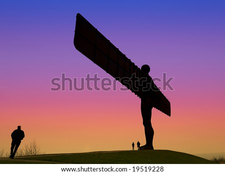 Angel Of The North at Sunset with couple standing at Base and Man dashing to join them - stock photo