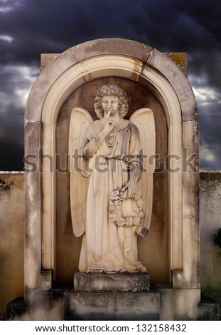 Angel on a grave stone in the cemetery. Silence - stock photo
