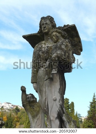 Angel statue in a graveyard - stock photo