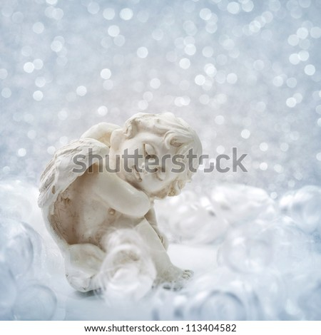 Angel statue on silver background - stock photo