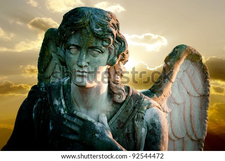 angel statue on sunset background - stock photo