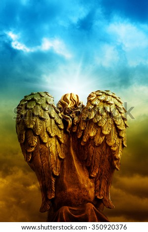 angel statue with divine light and copyspace - stock photo
