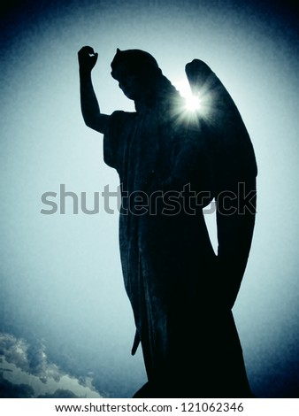 Angel with fist raised - stock photo