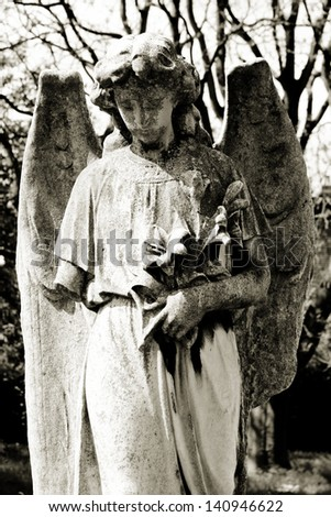 Angel with flowers - stock photo