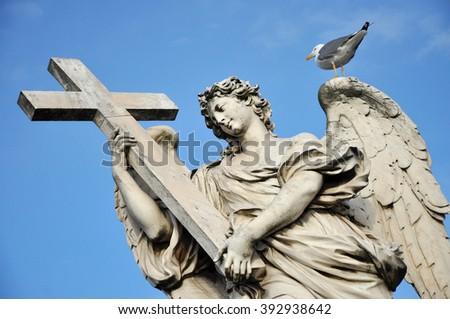 Angel with the Cross. Statue on the Ponte Sant' Angelo bridge, Rome - stock photo