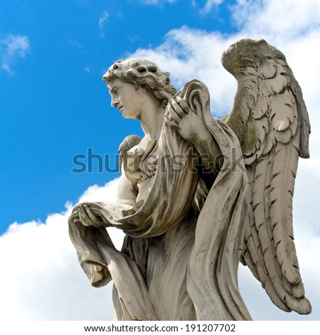 Angel with the garment and dice, Rome, Italy - stock photo