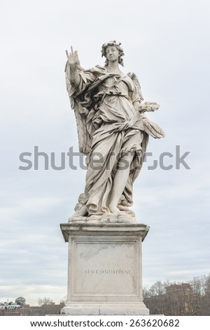Angel with the Nails is a statue on the Ponte Sant'Angelo in Rome, Italy. Ponte Sant'Angelo is a bridge in front of the Castel Sant'Angelo. - stock photo
