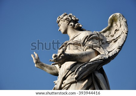 Angel with the Nails. Statue on the Ponte Sant' Angelo bridge, Rome - stock photo