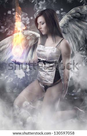 Angel With White Wings Woman Holding A Fireball Over Vintage Background
