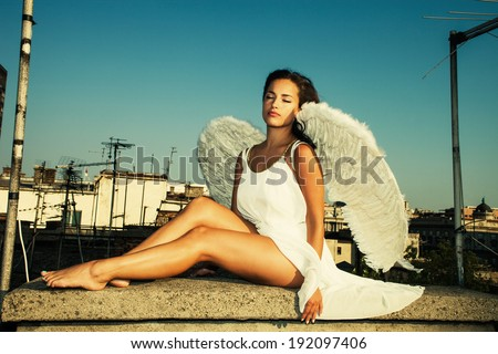 angel woman on building roof, summer day, Belgrade, Serbia