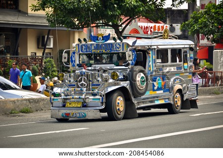 ANGELES CITY, PHILIPPINES - OCTOBER 9: Jeepney on the street on October 9, 2012 in Angeles City, Philippines. Jeepneys are the most popular means of public transportation in the Philippines. - stock photo