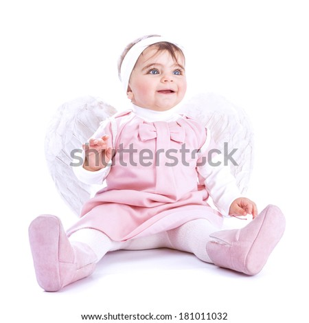 Angelic baby sitting in the studio isolated on white background, cute little girl wearing pink dress and feather wings, purity and innocence concept - stock photo