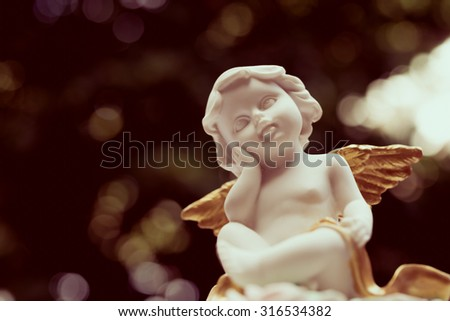 Angelic cupid statue - vintage retro effect style picture - stock photo