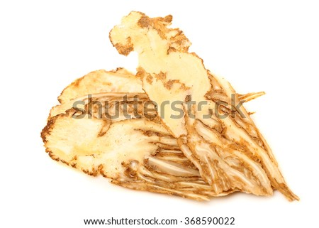 Angelica root used in chinese traditional herbal medicine, over white background. Radix angelicae sinensis, Dang gui.