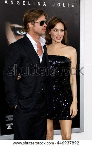 Angelina Jolie and Brad Pitt at the Los Angeles premiere of 'Salt' held at the Grauman's Chinese Theater in Los Angeles, USA on July 19, 2010. - stock photo