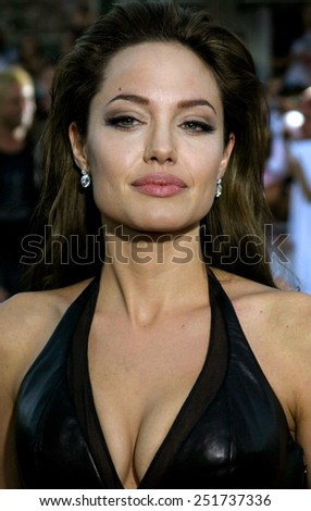 "Angelina Jolie attends the Los Angeles Premiere of ""Mr. & Mrs. Smith"" held at the Mann's Village Theater in Westwood, California on June 7, 2005.  - stock photo"