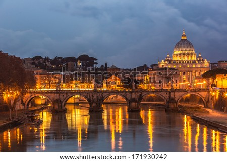 Angelo Bridge and St. Peter's Basilica at dusk, Rome, Italy - stock photo