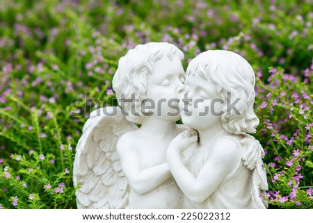 angels couple statue in garden - stock photo