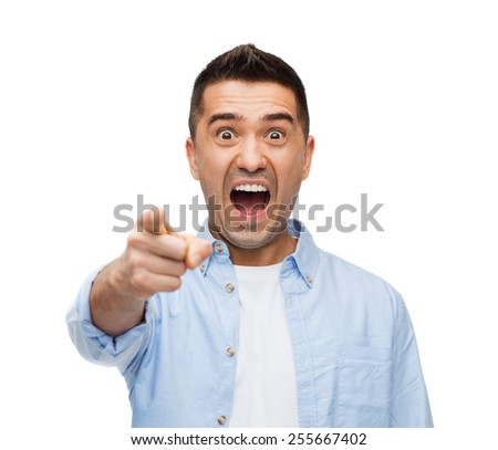 anger, fear, emotions, gesture and people concept - angry or scared man shouting and pointing finger on you - stock photo