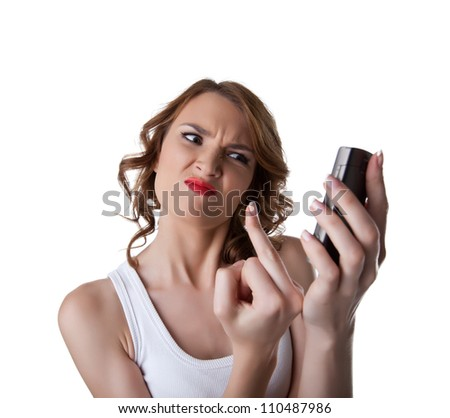 Anger Young woman show fuck finger on cell phone - stock photo