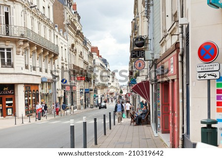 ANGERS, FRANCE - JULY 28, 2014: Rue Saint Aubin street in Angers, France. Angers is city in western France and it is the historical capital of the province of Anjou