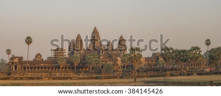 Angkhor Wat, 12th Century temple city of the God Kings, built by King Suryavarman II 1112-1152. Wide evening sunset panorama. Cambodia - stock photo