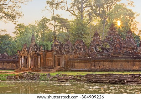 Angkor Banteay Srei temple gate at sunset - stock photo