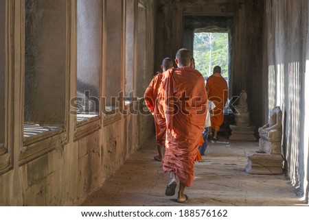 ANGKOR WAT, CAMBODIA - APRIL 16, 2014 - Unidentified Buddhist monks in Angkor Wat complex on April 16, 2014, Cambodia. Angkor Wat was first a Hindu, then subsequently, a Buddhist temple complex.