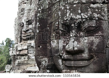 Angkor Wat stone carvings of faces - stock photo