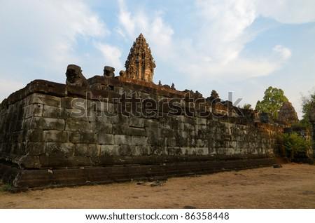 Angkor Wat temple at dusk - stock photo