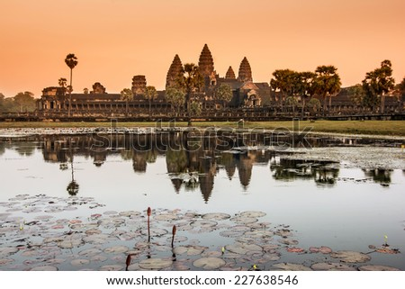 Angkor Wat was first a Hindu,then subsequently,a Buddhist temple complex in Cambodia and the largest religious monum. in the world.The temple was built by the Khmer King Suryavarman II in 12th century - stock photo