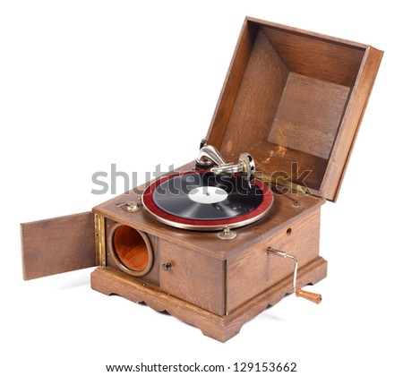Angle view of old wooden gramophone against white background - stock photo