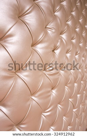 Angle view of  upholstery sofa leather pattern background in shallow depth of field - stock photo