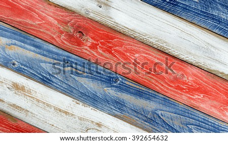 Angled faded wooden boards painted red, white and blue for patriotic concept of United States of America.