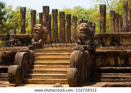 Angled view of the steps and lion carvings that lead to the audience hall, part of the ruins of the ancient kingdom capitol in Polonnaruwa, Sri Lanka