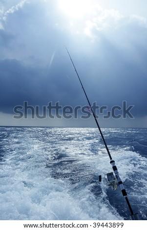 Angler boat big game fishing in saltwater ocean - stock photo