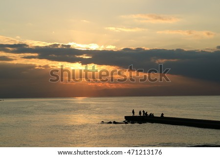 Angler of the breakwater and light of the sun coming through the clouds at Enoshima and Kamakura,Japan