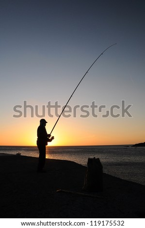 Angler's silhouette in the evening sun