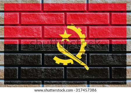 Angola flag painted on old brick wall texture background - stock photo