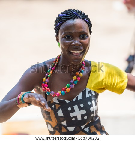 ANGOLA, LUANDA - MARCH 4, 2013: Close up of an Angolan beautiful woman dancing the national folk dance in Angola, Mar 4, 2013. Music is one of the main African entertainments. - stock photo