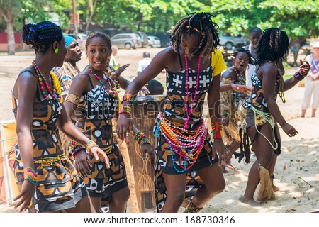ANGOLA, LUANDA - MARCH 4, 2013: Group of the Angolan women improvise a street concert in Angola, Mar 4, 2013. Music is one of the main African entertainments. - stock photo