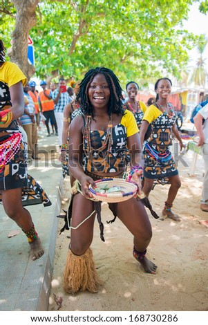ANGOLA, LUANDA - MARCH 4, 2013: Smiling Angolan woman dances the local folk dance in Angola, Mar 4, 2013. Music is one of the main African entertainments. - stock photo