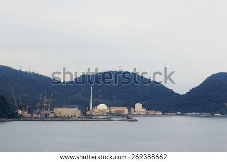 Angra Nuclear Power Plant in rainy day, Central Nuclear Almirante Alvaro Alberto, Rio de Janeiro, Brazil. Selective focus  - stock photo