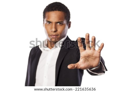 angry african guy showing stop hand - stock photo